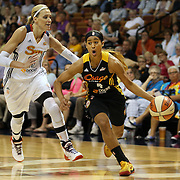 Skylar Diggins, (right), Tulsa Shock, drives to the basket past Katie Douglas, Connecticut Sun, during the Connecticut Sun Vs Tulsa Shock WNBA regular season game at Mohegan Sun Arena, Uncasville, Connecticut, USA. 3rd July 2014. Photo Tim Clayton