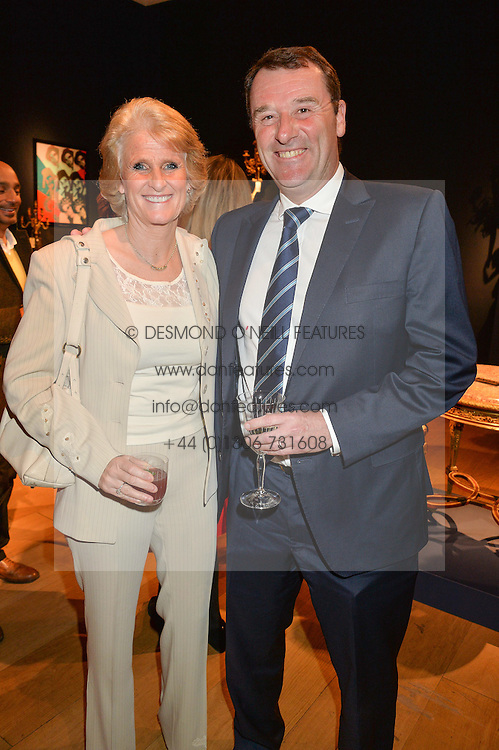 PHILIP & GILL BROOK he is chairman of the All England Club at a party to celebrate the publication of Interiors For Living by Joanna Wood held at Christie's. 8 King Street, St.James's, London on 2nd March 2015.