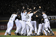 CHICAGO - SEPTEMBER 30:  A.J. Pierzynski , John Danks and the rest  of the Chicago White Sox celebrate after the game against the Minnesota Twins at U.S. Cellular Field in Chicago, Illinois on September 30, 2008.  The White Sox defeated the Twins 1-0 to win the American League Central title.  The Sox and Twins had to play a one game playoff to determine the American League Central Champion.  (Photo by Ron Vesely)