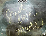 """When Tyrone Beason spotted the words """"Just love more"""" written in yellow crayon on a wall near downtown Seattle, it got him to rethink his frustration with the pace of growth and change. The man who wrote the message contacted him months later, after seeing a photo of his graffiti in Pacific NW magazine. (Tyrone Beason / The Seattle Times)"""