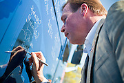 Aug 9, 2010 - SUN CITY WEST, AZ: J.D. HAYWORTH, a former US Congressman and right wing radio talk show host, signs the Spending Revolt Bus in Sun City West, AZ. Hayworth is running against Sen. John McCain in Arizona's Republican primary. Hayworth is hoping to capitalize on the Tea Party vote, though the Arizona Tea Party has not formally endorsed him. The Spending Revolt Bus stopped in Sun City West, a retirement community northwest of Phoenix, Monday. Spending Revolt is a new coalition of taxpayers and business owners concerned about government spending. The bus is attracting Republican and Tea Party affiliated candidates to its events. The bus has crisscrossed Nevada, California and Arizona and is heading east to Washington DC.   Photo by Jack Kurtz / ZUMA Press
