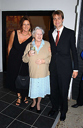 Left to right, KATHRYN IRELAND, MIMI the Goldsmith family nanny and BEN GOLDSMITH at a party hosted by Kathryn Ireland held at her showroom at 65-69 Lots Road, London on 27th September 2005.<br /><br />NON EXCLUSIVE - WORLD RIGHTS