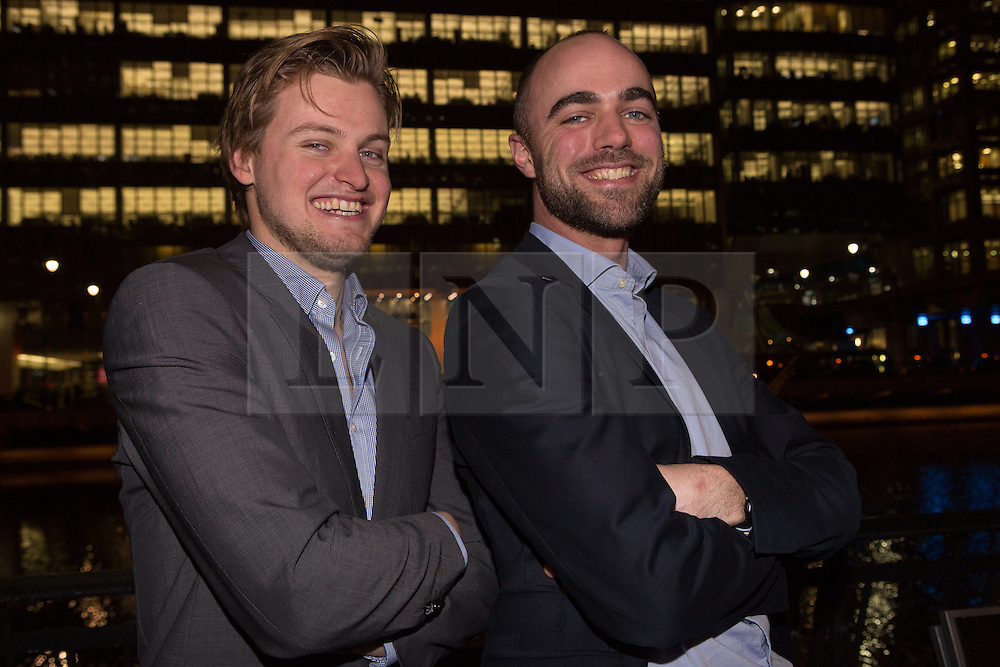 © Licensed to London News Pictures. 21/12/2013. London, UK. Image date: 16/12/2013. Rombout Frieling (left) and Luuk van Laake at the launch of the wind powered light display called 'fLUMENS' at Canary Wharf in London on 16 December 2013. 'fLUMENS' was created by Dutch artist Rombout Frieling and Luuk van Laake who is a former wind engineer now working for DigiLuce. The 'fLUMENS' are solely powered by the wind and have been built to withstand gusts up to gale force 10 on the Beaufort scale.. Photo credit : Vickie Flores/LNP