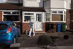 © Licensed to London News Pictures . 17/01/2015 . Stockport , UK . A forensic scenes of crime examiner leaves  28 Meadway Road , Cheadle Hulme , Stockport this afternoon (Saturday 17th January 2015 ) after a woman and a man - named as magistrate Yvonne Davies and her husband Andrew - were found dead inside after an apparent murder-suicide last night (16th January 2015) .  Photo credit : Joel Goodman/LNP