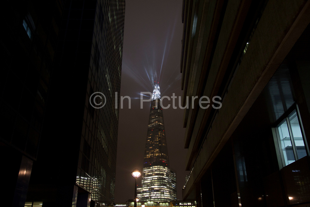 London's tallest skyscraper, the Shard, beams out spotlights as part of a light show creating a public art installation in the sky on 13th December 2016 in London, England, United Kingdom. (photo by Mike Kemp/In Pictures via Getty Images)