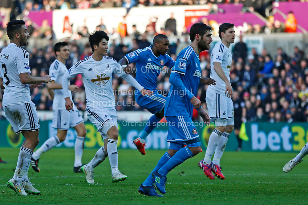 Jermain Defoe of Sunderland (centre) scores his side's first goal.<br /> Barclays Premier League match, Swansea City v Sunderland at the Liberty stadium in Swansea, South Wales on Saturday 7th Feb 2015.<br /> pic by Mark Hawkins, Andrew Orchard sports photography.