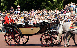 Queen Elizabeth II and The Duke of Edinburgh make their way down The Mall from Buckingham Palace, central London to Horse Guards Parade for the Trooping the Colour ceremony as the Queen celebrates her official birthday today.