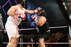 Owen Mahidol (black? vs Rob Pugsley (pink) boxing at the Boodles Boxing Ball, in association with Argentex and YouTube in Support of Hope and Homes for Children at Old Billingsgate London, United Kingdom - 7 Jun 2019 Photo Dominic O'Neil
