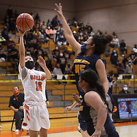 Gallup Bengal Kennedy Smiley (12) takes a shot during their New Mexico Class 4A girls basketball quarterfinal game against the Highland Hornets Tuesday in Gallup. The Bengals defeated the Hornets 53-51 to advance to the semifinals.