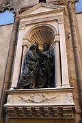 Statue detail on the outside of a church in Florence, Italy. Semi enclosed figurative statues such as this appear all over Florence.