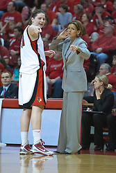 28 March 2010: Nicolle Lewis and Robin Pingeton discuss a set up while everyone else is at the other end of the court for a free throw.  The Redbirds of Illinois State squeak past the Illini of Illinois 53-51 in the 4th round of the 2010 Women's National Invitational Tournament (WNIT) on Doug Collins Court inside Redbird Arena at Normal Illinois.