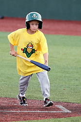11 July 2012:  Batboy Craig Bland of Hudson Illinois retrieves a bat during the Frontier League All Star Baseball game at Corn Crib Stadium on the campus of Heartland Community College in Normal Illinois