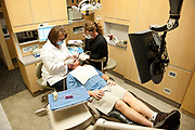 View from above of a dentist working on a patient.