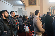 Mr Naim Leziye from Syria (2nd from left wearing a red jumper), the acting head of the Syrian Christian community at the Samatya Kilisesi in Istanbul's historic Fatih neighbourhood during the Sunday service.