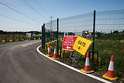 A sign indicates a gate to a construction site in the Colne Valley for the HS2 high-speed rail link on 26th June 2020 in Harefield, United Kingdom. Extensive preparatory works for the HS2 project continue in the Colne Valley in spite of stubborn resistance from environmental campaigners seeking to protect woodland and wetland habitats in the area.