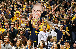 Jan 15, 2018; Morgantown, WV, USA; West Virginia Mountaineers students celebrate during the first half against the Kansas Jayhawks at WVU Coliseum. Mandatory Credit: Ben Queen-USA TODAY Sports