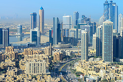 Skyline of Dubai with Old Town housing development foreground and Business Bay at Rear Dubai United Arab Emirates