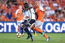 December 17, 2017 - Brisbane, QUEENSLAND, AUSTRALIA - Thomas Deng of Melbourne Victory (14, left) controls the ball in front of Massimo Maccarone of the Roar (9) during the round eleven Hyundai A-League match between the Brisbane Roar and the Melbourne Victory at Suncorp Stadium on Sunday, December 17, 2017 in Brisbane, Australia. (Credit Image: © Albert Perez via ZUMA Wire)