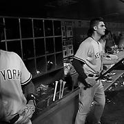 Chris Young, (left) and Greg Bird, New York Yankees, in the dugout preparing to bat during the New York Mets Vs New York Yankees MLB regular season baseball game at Citi Field, Queens, New York. USA. 18th September 2015. Photo Tim Clayton