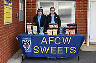 AFC Wimbledon fans selling sweets called AFC Sweets during the EFL Sky Bet League 1 match between AFC Wimbledon and Doncaster Rovers at the Cherry Red Records Stadium, Kingston, England on 14 December 2019.