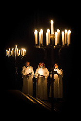 © Licensed to London News Pictures. 27/11/2016. York UK. The candle light Advent procession took place at York Minster last night (Sunday 27th) the Minster Advent procession start's in darkness, gradually light spreads through the Cathedral as candle light is passed from one person to the next. The candle light event is a service of Advent music, readings & prayers in celebration of God's promise of Jesus Christ , the light of the world. Photo credit: Andrew McCaren/LNP
