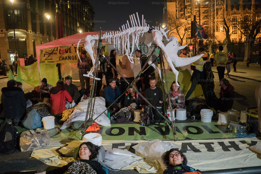 April, 18th, 2019 - London, Greater London, United Kingdom: Rhinoceros skeleton. Westminster Parliament Square Demonstration against Climate Crisis. Extinction Rebellion is demanding the UK government takes urgent action on climate change and wildlife declines. Extinction Rebellion activists disrupt traffic around famous London Landmarks. Thousands of protesters  converging on central hubs including Oxford Circus and Parliament Square. Nigel Dickinson/Polaris