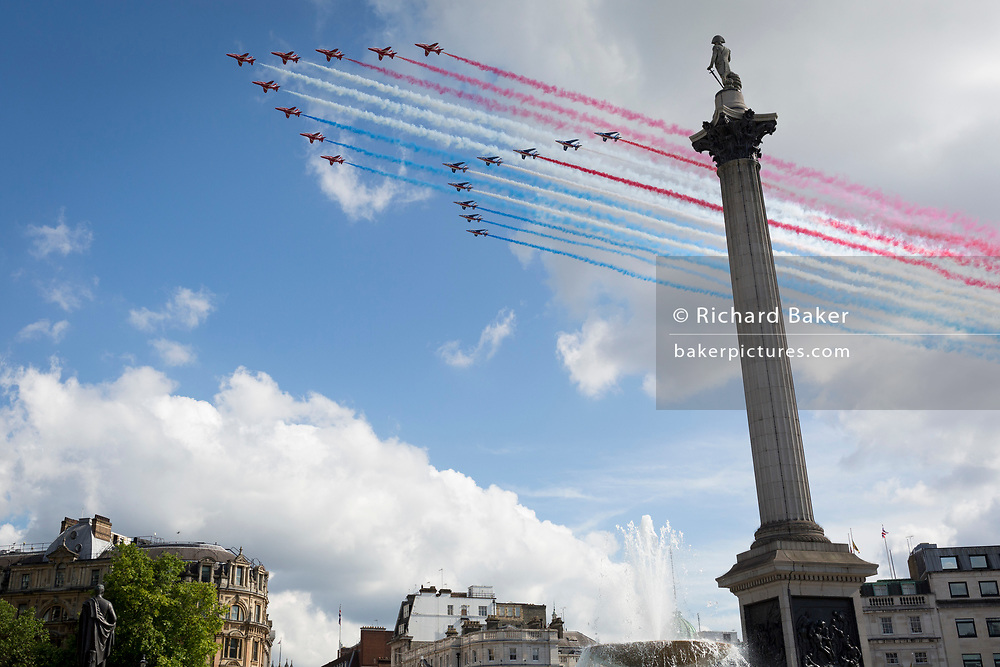 On the day French President Emmanuel Macron visits London to celebrate the 80th anniversary of Charles de Gaulle's famous wartime broadcast calling French citizens to arms against Nazi occupiers, the British Royal Air Force's Red Arrows aerobatic team lead their French aviation counterparts, La Patrouille de France, over Nelson's column in Trafalgar Square, on 18th June 2020, in London, England.