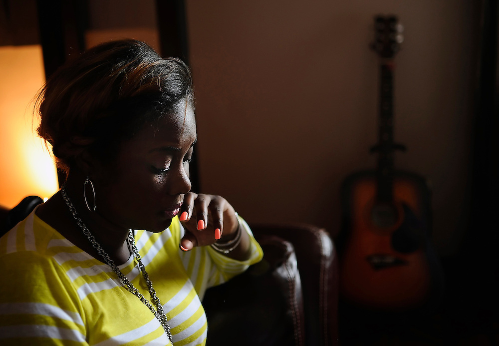 Nekita Waller reviews lyrics before heading into a booth to record backing vocals for a Gospel song.
