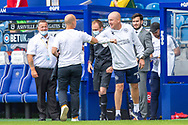 Barnsley Manager Gerhard Struber touches elbows with Queens Park Rangers Manager Mark Warburton before the EFL Sky Bet Championship match between Queens Park Rangers and Barnsley at the Kiyan Prince Foundation Stadium, London, England on 20 June 2020.
