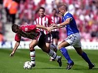 Fotball<br /> Premier League England<br /> 23.08.2003<br /> Foto: Digitalsport<br /> Norway Only<br /> <br /> Photo: Richard Lane.<br />Southampton v Birmingham City. Barclaycard Premiership.<br />23/08/2003.<br />Kevin Phillips breaks away from Matthew Upson.