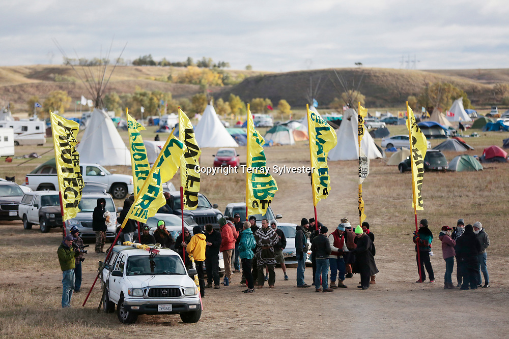 Opponents of the Dakota Access oil pipeline hold banners in their camp on November 5, 2016. Cannon Ball, North Dakota, United States.