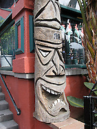 USA: California: San Diego County, San Diego: A hand-carved tiki welcomes visitors to The Shack, a restaurant in La Jolla, California that is popular with locals.