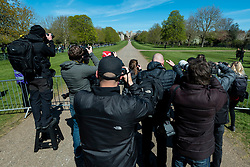 © Licensed to London News Pictures. 17/04/2021. WINDSOR, UK. Members of the media photograph The King's Troop Royal Horse Artillery on the Long Walk en route to Windsor Castle on the day of the funeral of Prince Philip who died on 9 April, aged 99.  Coronavirus pandemic restrictions have limited the number of mourners to 30 close family members at the 3pm funeral at Windsor Castle.  Photo credit: Stephen Chung/LNP