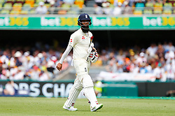 England's Moeen Ali walks off after being dismissed during day two of the Ashes Test match at The Gabba, Brisbane.
