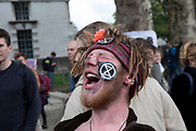 Extinction Rebellion climate change activist screams as sites around Westminster are blocked on 8th October 2019 in London, England, United Kingdom. Extinction Rebellion is a climate group started in 2018 and has gained a huge following of people committed to peaceful protests. These protests are highlighting that the government is not doing enough to avoid catastrophic climate change and to demand the government take radical action to save the planet.