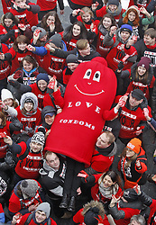 Feb. 13, 2016 - Kiev, Ukraine - Ukrainian students,volunteers and man dressed in a Condom suit during a flash mob called ''Wrap your love!'' as they mark the International Condom Day at World War II open air Museum. The event was promoted by AIDS Healthcare Foundation to promote the prevention of sexually transmitted diseases (STD) like HIV and unwanted pregnancies through condom distribution, to create awareness towards safe sex and timed to the International Condom day. (Credit Image: © Vasyl Shevchenko/Pacific Press via ZUMA Wire)