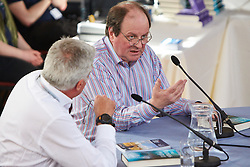 © Licensed to London News Pictures.  22/03/2014. OXFORD, UK. James Naughtie, Radio 4 Today programme presenter and author, speaking at an Oxford Literary Festival event in the Sheldonian Theatre about his new thriller The Madness of July. <br /> <br /> In this picture: Paul Blezard (left) and James Naughtie (right)<br /> <br /> Photo credit: Cliff Hide/LNP