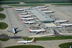 © Licensed to London News Pictures. 17/12/13. London, UK Extra runways at Heathrow and Gatwick airports are among the options put forward by the Government-appointed Airports Commission in its first report today 17th December 2013.  FILE PICTURE DATED 01/02/2011. Aerial view of Heathrow Airport in London, UK. Photo credit : LNP