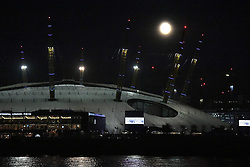 The moon over the O2 Arena in south-east London, as a rare supermoon will make the full lunar disc appear 14\% bigger and up to 30\% brighter than usual as it rises above the rooftops on Monday.