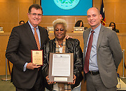 Houston ISD superintendent Dr. Terry Grier, left, Wretha Thomas, center, and Nathan Graf, right, pose for a photograph after the Transportation department was recognized for a national award during the Board of Education meeting, November 13, 2014.