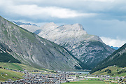 The Bernina Pass (elevation. 2328 m.) is a high mountain pass in the Bernina Range of the Alps, in the canton of Graubünden (Grisons) in eastern Switzerland. It connects the famous resort town of St. Moritz in the Engadin valley with the Italian-speaking Val Poschiavo, which ends in the Italian town of Tirano in Valtellina.