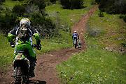 Brad Black following other riders down a hill on his Kawasaki KDX-200 at Crossbar Ranch ORV area in Davis, Oklahoma.
