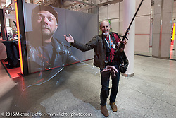 Michael Lichter and Swedish chopper builder Johnny Martinsson having some fun at the Intermot Motorcycle Trade Fair. Cologne, Germany. Wednesday October 5, 2016. Photography ©2016 Michael Lichter.`