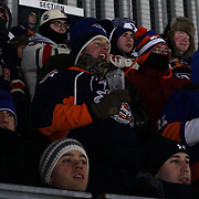 Rangers and Islanders fans brave the cold to watch their team at Yankee Stadium during the New York Rangers Vs New York Islanders  NHL regular season game held outdoors at Yankee Stadium, The Bronx, New York, USA. 29th January 2014. Photo Tim Clayton