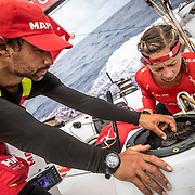 Leg 02, Lisbon to Cape Town, day 12, on board MAPFRE, Guillermo Altadil and Sophie Ciscek fixing the main sail's winch. Photo by Ugo Fonolla/Volvo Ocean Race. 16 November, 2017