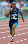 Maurice Greene of the United States in the first round of the 100 meters in the IAAF World Championships in Athletics at Stade de France on Sunday, Aug, 24, 2003.