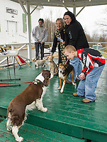 """Alfie"" joins other dogs in the gazebo for the animal blessing with Pastor Ruth Martz at the Sanbornton Congregational Church on Sunday evening.  (Karen Bobotas/for the Laconia Daily Sun)"