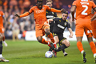 Luton Town player Kazenga LuaLua is tackled heavily in the first half during the EFL Sky Bet League 1 match between Luton Town and AFC Wimbledon at Kenilworth Road, Luton, England on 23 April 2019.