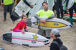 June 20, 2017 - Huntington Beach, California, USA - Pro surfers Courtney Conlogue, left, of Santa Ana and Brett Simpson of Huntington Beach wait with nearly 600 surfers to make their way into  the ocean to create the world's largest paddle out ''Surfing Circle of Honor'' in Huntington Beach Tuesday morning, June  20, 2017. (Photo by Mark Rightmire, Orange County Register/SCNG) (Credit Image: © Mark Rightmire, Mark Rightmire/The Orange County Register via ZUMA Wire)