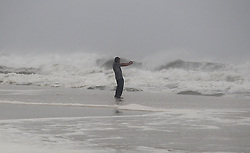 A man takes selfies defying the strong winds near to the city pier early morning in Panama City Beach, as Florida's Panhandle prepares for its worst hurricane strike in at least a decade as Michael gained power overnight, on track to strike somewhere near Panama City Wednesday afternoon, Oct. 10, 2018. Photo by Pedro Portal/Miami Herald/TNS/ABACAPRESS.COM